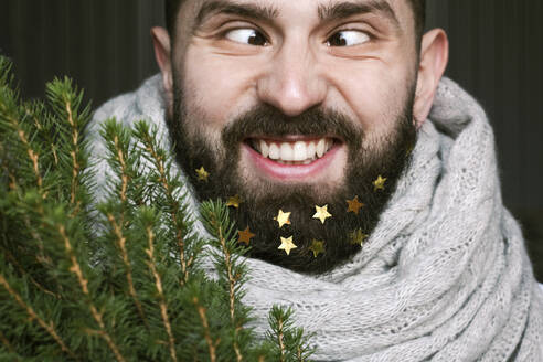 Funny man with Christmas tree and golden stars in his beard - EYAF00773