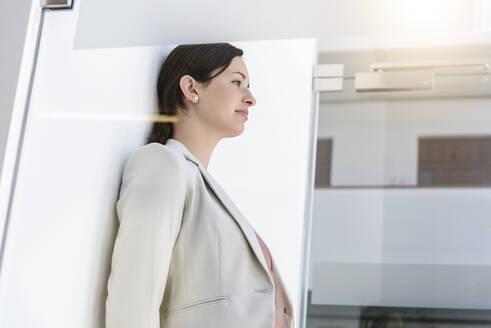 Portrait of young businesswoman having a break in office - BMOF00110