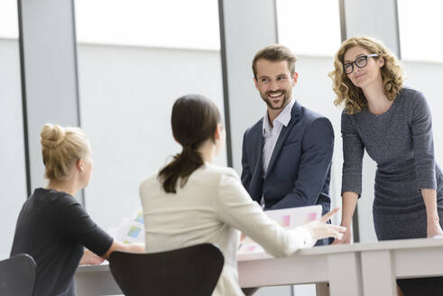 Confident business team having a meeting in office - BMOF00116