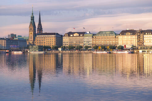 Germany, Hamburg, Town hall seen across Alster lake at sunset - IHF00200