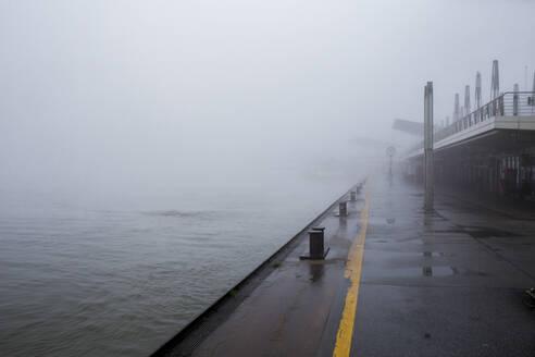 Germany, Hamburg, Heavy fog covering the Landungsbrucken - IHF00209