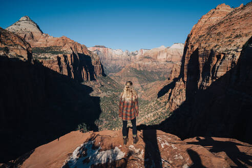 Girl over watching the scenic landscape of Zion National Park - CAVF71357