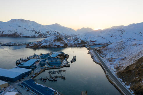Aerial view of sunrise over the isolated city of Unalaska, AK, USA. - AAEF06059