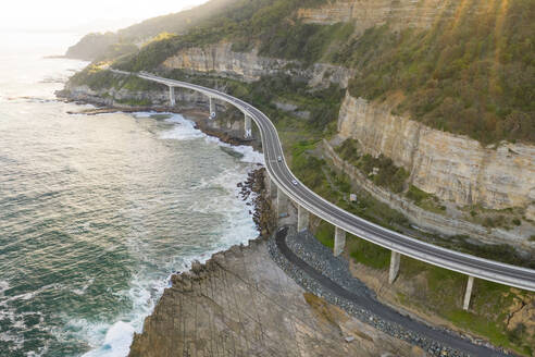 Aerial view of road crossing coastal line at New South Wales, Australia - AAEF06092