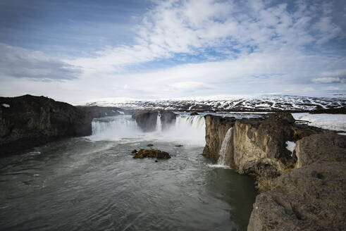 Scenic view waterfall against sky during winter - CAVF72433