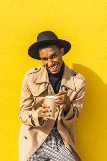 Young man enjoying his take-out coffee - AFVF04566