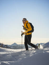 Hiking with snowshoes in the mountains, Valmalenco, Sondrio, Italy - MCVF00141
