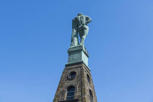 Germany, Hesse, Kassel, Low angle of Hercules monument in Bergpark Wilhelmshohe - RUNF03495