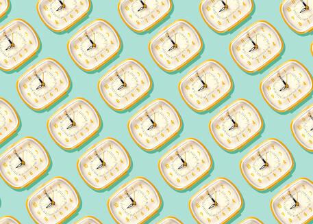 3D Illustration, row of yellow alarm clocks at nine o'clock pattern on turquoise background - GEMF03370