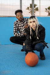 Young couple with basletball - RCPF00206