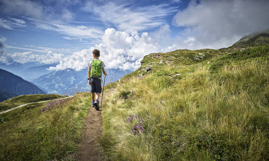 Boy hiking in alpine scenery, Passeier Valley, South Tyrol, Italy - DIKF00333
