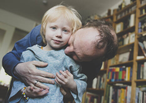 Father hugging his little daughter at home - IHF00248