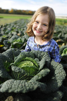 Smiling girl in a savoy field - ECPF00786