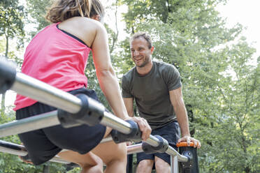 Man and woman exercising on a fitness trail - FBAF01104