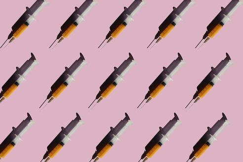 3D Illustration of syringes, pink background - ERRF02408
