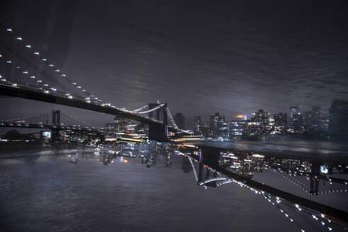 USA, New York, New York City, Manhattan Bridge illuminated at night - CJMF00232