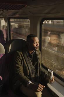 Stylish man traveling by train - AHSF01637