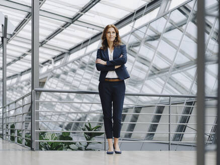 Portait of a confident businesswoman in a modern office building - JOSF04143