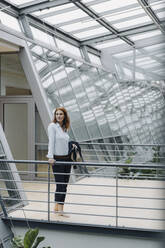 Portait of a confident businesswoman in a modern office building - JOSF04194