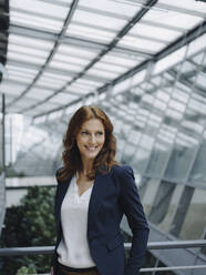 Portait of a confident businesswoman in a modern office building - JOSF04221