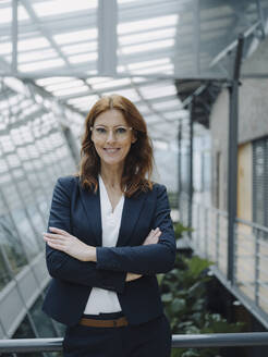 Portait of a confident businesswoman in a modern office building - JOSF04224