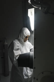 Scientist working in clean room of a laboratory - AHSF01834