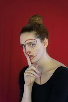 Portrait of young woman with paint on her face - AFVF04798