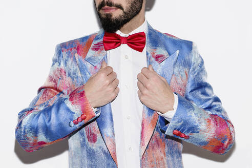 Stylish man wearing a colorful suit and a red bow tie - LOTF00084