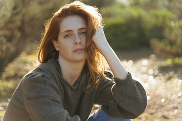 Portrait of beautiful redheaded young woman outdoors at sunset - AFVF04848