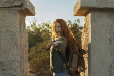 Portrait of happy redheaded young woman on a hiking trip, Ibiza, Spain - AFVF04854