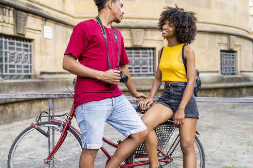 Happy young couple with bicycle in the city, Florence, Italy - FBAF01152