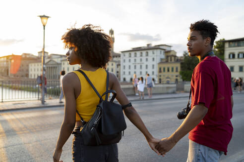 Young tourist couple exploring the city at sunset, Florence, Italy - FBAF01164