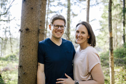 Portrait of happy couple in a forest - DAWF01068
