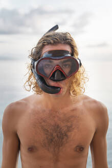 Young man with snorkel on beach - AFVF04976