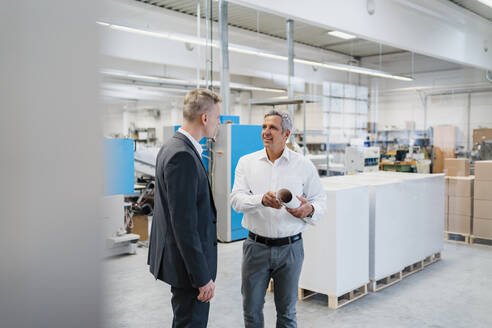 Two businessmen talking in a factory - DIGF09169