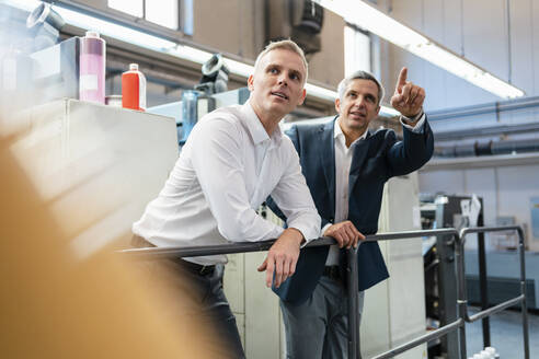Two businessmen talking in a factory - DIGF09208