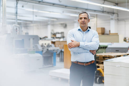 Portrait of a confident businessman in a factory - DIGF09241
