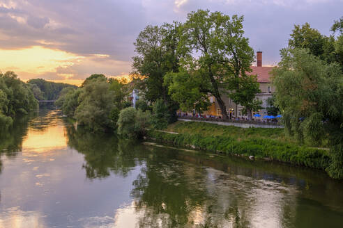 Germany, Bavaria, Regensburg, Danube river and edge of Stadtamhof borough at dusk - SIEF09376