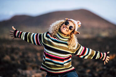 Portrait of woman wearing colorful pullover, Tenerife, Spain - SIPF02108