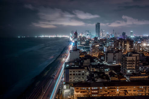 Sri Lanka, Western Province, Colombo, High angle view of coastal city at night - DAWF01120