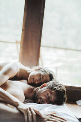 Sri Lanka, Naked couple sleeping together in bed - DAWF01144