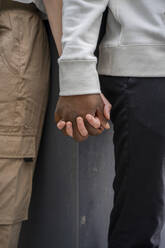 Man and woman holding hands - AFVF04999