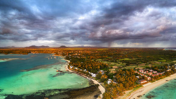 Dramatic sky at dawn over Trou d'Eau Douce coastline, aerial view, Flacq district, East coast, Mauritius, Indian Ocean, Africa - RHPLF13608