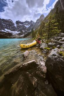 A woman prepares for a rafting trip across Cirque Lake in Banff. - CAVF72786