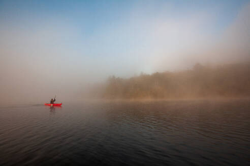 Paddling on a misty pond. - CAVF72858