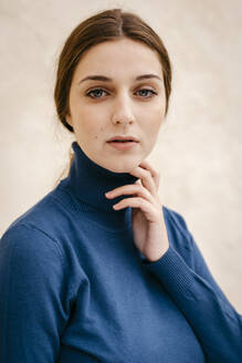 Close up portrait of woman with blue turtleneck pullover - TCEF00013