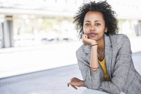 Portrait of confident young businesswoman outdoors - UUF20208