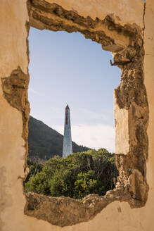 Spain, Mallorca, Tower seen through window of ruined building - JMF00478