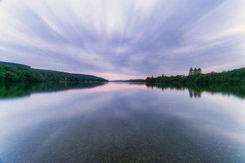 UK, England, Long exposure of clouds over Coniston Water lake at dusk - SMAF01713