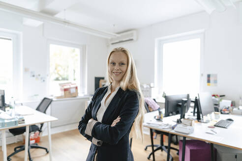 Portrait of a smiling young businesswoman in office - GUSF03195